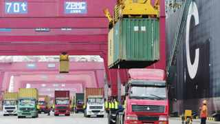 Trucks are loaded with shipping containers at a port in Qingdao, Shandong province. African products were increasingly being recognised in the Chinese market. Pictures: Reuters.