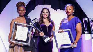 Tshegofatso Mnguni (left), Sarika Modi, the managing director of Triple Eight with a representative of the Gender Mainstream Awards when they won a prior award. They have now also won the Shorty Award.