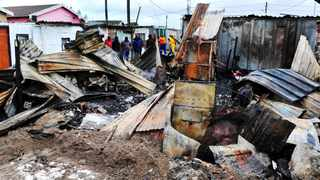 Two children died and 17 shacks burned down in Phola Park, Gugulethu. Photo: Phando Jikelo/ANA