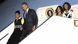 U.S. President Barack Obama (2nd L) and first lady Michelle Obama (R) arrive with their daughters Sasha (L) and Malia in Dakar. REUTERS/Jason Reed
