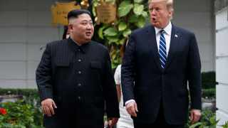 U.S. President Donald Trump and North Korean leader Kim Jong Un take a walk after their first meeting at the Sofitel Legend Metropole Hanoi hotel. Picture: AP Photo/Evan Vucci
