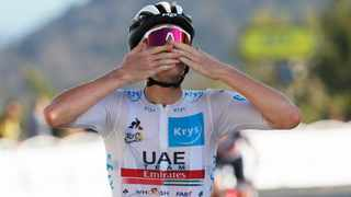 UAE Team Emirates rider Tadej Pogacar of Slovenia, wearing the white jersey for best young rider, crosses the finish line to win stage 15. Photo: Thibault Camus/Reuters
