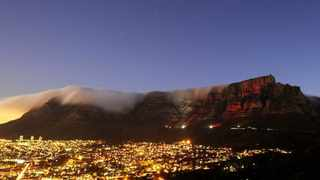 UNDER A CLOUD: Capetonians voted for Table Mountain as one of the New 7 Wonders of the World, which was nothing more than a profitable business, the writer argues.