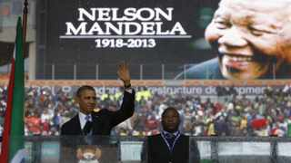 US President Barack Obama addresses the crowd during a memorial service for Nelson Mandela at FNB Stadium. Picture: Kevin Lamarque