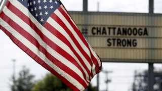 US flag flies alongside a sign in honor of the four Marines killed in Chattanooga, Tennessee. Picture: Tami Chappell