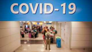 Vacationers arriving in Rome from four Mediterranean countries line up with their suitcases at Rome's Leonardo da Vinci airport to be immediately tested for Covid-19. Picture: Andrew Medichini/AP