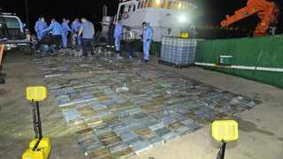 Various tactical forces descending on the vessel where 973 blocks of compressed cocaine (estimated at R583 million) were found.   SAPS Supplied