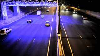 Vehicles pass the toll gantries on the N4. Photo: Phill Magakoe