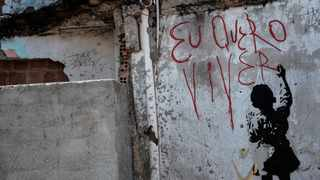 """View of a graffiti reading """"I want to live"""" at a shantytown of the Alemao complex in Rio de Janeiro, Brazil, on April 8, 2015. Picture: Yasuyoshi Chiba/ AFP"""
