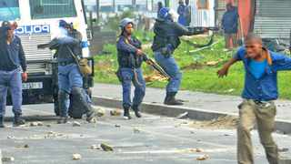 Violence erupted at Marikana informal settlement in Philippi when law enforcement officers started breaking down shacks. Picture Brenton Geach