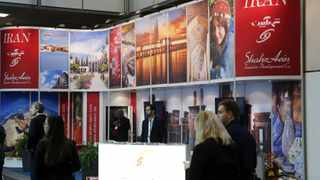 Visitors browse the exhibition stand of Iran at the International Tourism Trade Fair (ITB) in in Berlin.