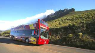 Visitors take in the sights of Cape Town's Table Mountain from an open-topped tour bus. South Africa has been ranked first in Sub-Saharan Africa on the biennial World Economic Forum Travel's global Travel and Tourism Competitiveness Index.