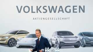 Volkswagen chief executive Herbert Diess arrives for a news conference in Wolfsburg, Friday. Volkswagen says it will invest €44 billion in developing autonomous and electric cars. Photo: AP