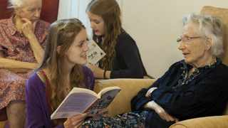 Volunteers from the 'Kissing it Better' charity read poems and recite songs to residents of a retirement home in Stratford upon Avon who have been diagnosed with dementia.