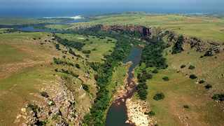 WILD COAST TOLL ROAD 4 JOHN YELD (John Yeld pic) 24.03.2004 THE PROPOSED NEW N2 WILD COAST TOLL ROAD WILL HAVE TO CROSS SEVERAL HUGE RIVER GORGES IN RURAL PONDOLAND, INCUDING THE MTENTU GORGE WHICH WILL REQUIRE A HUGE BRIDGE