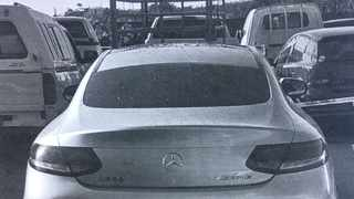 'WOOLIES looter', Mbuso Moloi's Mercedes-Benz C300 Coupe seen in the State pound. Picture Supplied.