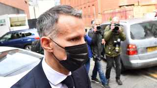 Wales' Manager and Former Manchester United footballer Ryan Giggs leaves from Manchester Magistrates' Court. Photo: Paul Ellis/AFP