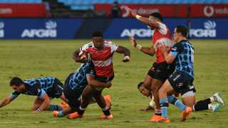 Wandisile Simelane of Lions tackled by Stravino Jacobs of Bulls during the Carling Black Label Currie Cup. Photo: Sydney Mahlangu/BackpagePix