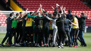 Watford staff and players celebrate promotion to the Premier League at the end of their match against Millwall at Vicarage Road on Saturday. Photo: Matthew Childs/Reuters