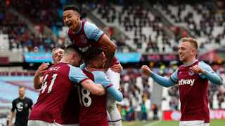 West Ham United's Pablo Fornals celebrates with teammates after scoring their second goal during their Premier League game against Southampton on Sunday. Photo: Andrew Boyers/Reuters