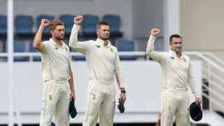 Wiaan Mulder (L), Aiden Markram (C) and Dean Elgar (R) of South Africa show support for Black Lives Matter during day 1 of the 1st Test between South Africa and West Indies. Photo: Randy Brooks/AFP