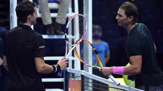 Winner Dominic Thiem (left) of Austria greets Rafael Nadal of Spain after their group stage match at the ATP Finals in London, Britain, 17 November 2020. Photo: EPA/Andy Rain