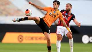 Wolverhampton Wanderers' Raul Jimenez kicks the ball next to Bournemouth's Steve Cook during their English Premier League match at the Molineux Stadium in Wolverhampton on Wednesday. Photo: Mike Egerton/AP