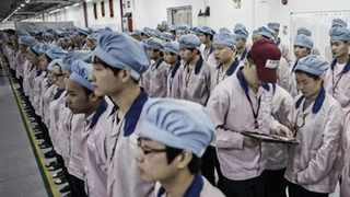 Workers inside the Pegatron factory in Shanghai, where as many as 50 000 people assemble iPhones. Picture: Twitter/@AppleMinute