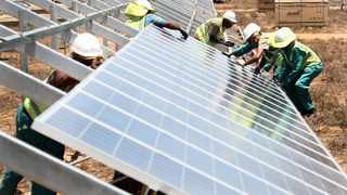 Workers of PiA solar fits a solar panel in De Aar , Nothern Cape. Photo : Nicholas Rama