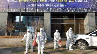 Workers wearing protective gears spray disinfectant against the coronavirus in front of a church in Daegu, South Korea. Picture: Lee Moo-ryul/Newsis via AP/African News Agency (ANA)