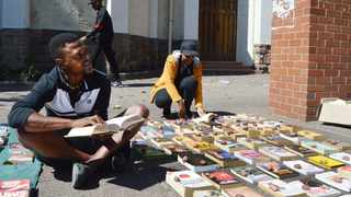 Xolani Mabunda, 35, sells books and enjoys reading them. He said his wish was to see more African people warm up to the idea of reading books as it will equip them with a lot of wisdom, expand their thinking, reasoning, capacity and help them sharpen their vocabulary. Picture: Tumi Pakkies/African News Agency (ANA)