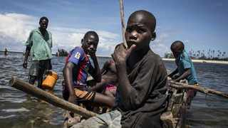 Young Mozambican fishermen return to the shore after fishing in Palma. File picture: AFP