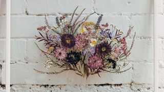 Your whole bouquet can be pressed and dried and then framed between two pieces of glass, creating a stunning and sentimental piece of wall art. Picture: Pinterest