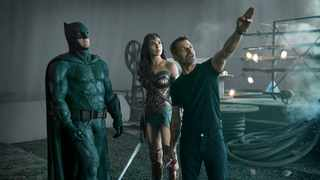Zack Snyder, right, directs Batman (Ben Affleck) and Wonder Woman (Gal Gadot) during filming of 'Justice League'. Picture: Clay Enos