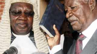 Zambian opposition leader Michael Sata (right) sworn in as president in the capital, Lusaka, on September 23, 2011. Sata, a critic of Chinese investment, was sworn in after an upset victory that ushered in a handover of power in Africa's biggest copper producer.  File photo: Makson Wasamunu