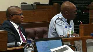 Police Minister Fikile Mbalula and the police's head of statistics, Major General Norman Sekhukhune, present South Africa's crime stats to MPs on Tuesday. PHOTO: Chantall Presence/ANA