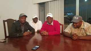Kudzanayi Chipanga (left), Ignatius Chombo (in red jersey) and Innocent Hamandishe (right) pose for a picture with an unidentified Zanu PF activist donning the caps.