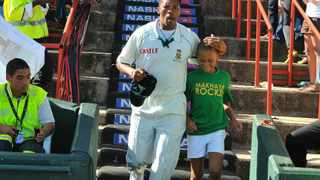 Makhaya Ntini walking down with his son, Thando Ntini, on his 100th Test match between South Africa and England in Centurion in 2009. Picture: ICC