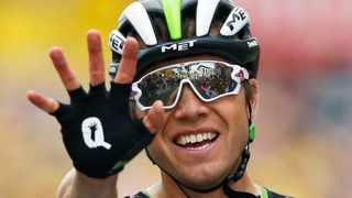 FILE PHOTO: Norway's Edvald Boasson Hagen celebrates as he crosses the finish line to win the nineteenth stage of the Tour de France in 2017. Photo: Peter Dejong/AP