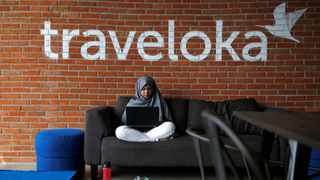 An employee of Traveloka works at the company's headquarters in Jakarta