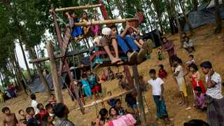 In this Sept. 3, 2017 photo, Rohingya children play during Eid at Kutupalong refugee camp, Bangladesh. This massive refugee camp was set up in the early 90s to accommodate the first waves of Rohingya Muslim refugees who started escaping convulsions of violence and persecution in Myanmar. file picture: AP Photo/Bernat Armangue