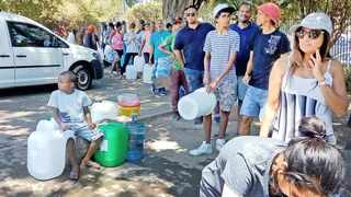 Capetonians queue for water at the Newlands Spring