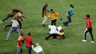 After the final whistle of the Nedbank Cup semi-final between hosts Kaizer Chiefs and Free State Stars, hundreds of fans invaded the pitch and the security officers were unable to cope adequately with the rampaging fans. Photo: Motshwari Mofokeng/ANA