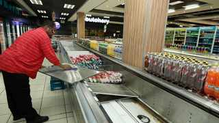 A supermarket employee cleans shelves where cold meat products identified as the main causes of listeriosis disease in South Africa were removed earlier this year. Picture : Simphiwe Mbokazi/ANA