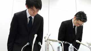 In this Friday, Jan. 26, 2018, photo, Coincheck President Koichiro Wada, left, bows in apology at the beginning of a news conference in Tokyo. Japanese media say the Coincheck exchange has lost 58 billion yen ($530 million) in cryptocurrency because of hacking. (Takuya Inaba/Kyodo News via AP)