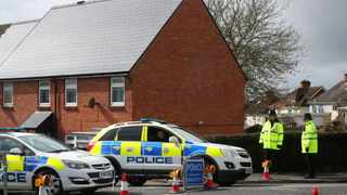 Police officers guard the cordoned off area around the home of former Russian intelligence officer Sergei Skripal in Salisbury