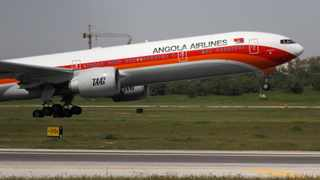 TAAG Angola Airlines Boeing 777 plane takes off from Lisbon's airport