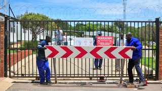 Members of the school governing body and workers reopen the gate at Amandasig Secondary School that was welded shut by residents to prevent traffic congestion in the street. Picture: Bongani Shilubane/African News Agency(ANA)