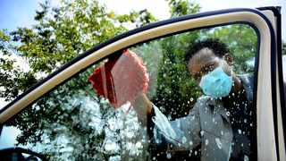 A car washer from Leondale in East Rand wears a mask as he works. South Africa could face a national shutdown if the Covid-19 virus continues to spread.Picture:Nokuthula Mbatha/African News Agency(ANA)