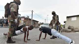 SANDF members force people to do push-ups in Alexandra during the 21-day lockdown. Picture: Bongani Shilubane/African News Agency (ANA)